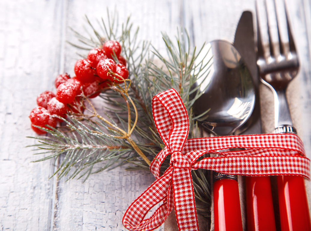 Christmas  Table Setting with Christmas pine branches.Cutlery,fork,spoon,knife on White Wooden Background with crackling effect. Holiday Decorations.top view. Copy space. selective focus.